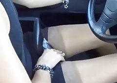Secretary driving and also masturbating in high heels stiletto