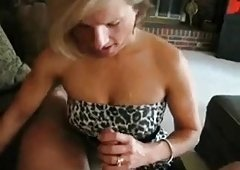 Golden-haired cougar sucking younger cock