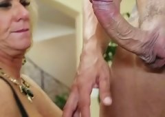 Horny granny with massive tits rides her lover's cum cannon in cowgirl position