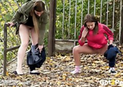 A Duo freaky darksome haired teens piss a lot outdoors